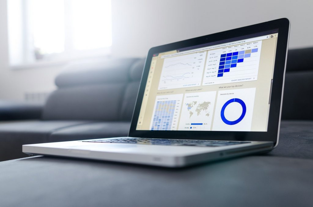Photo of laptop showing business dashboard as part of outsourcing accounts